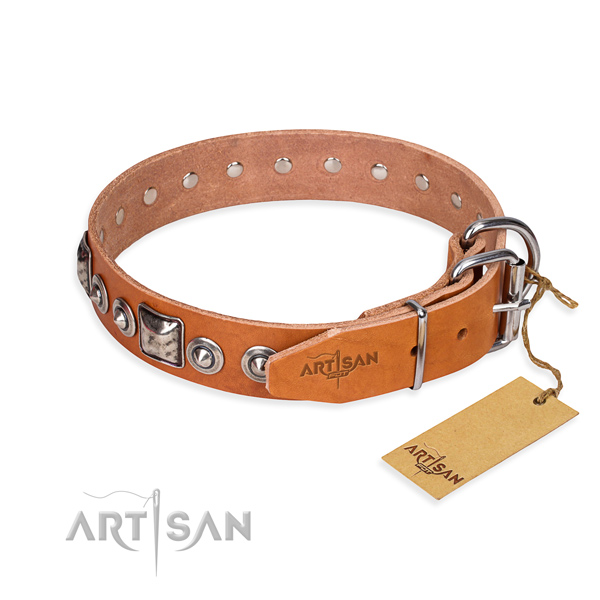Leather dog collar made of flexible material with rust-proof adornments